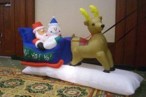 Santa in sleigh with 1 Reindeer